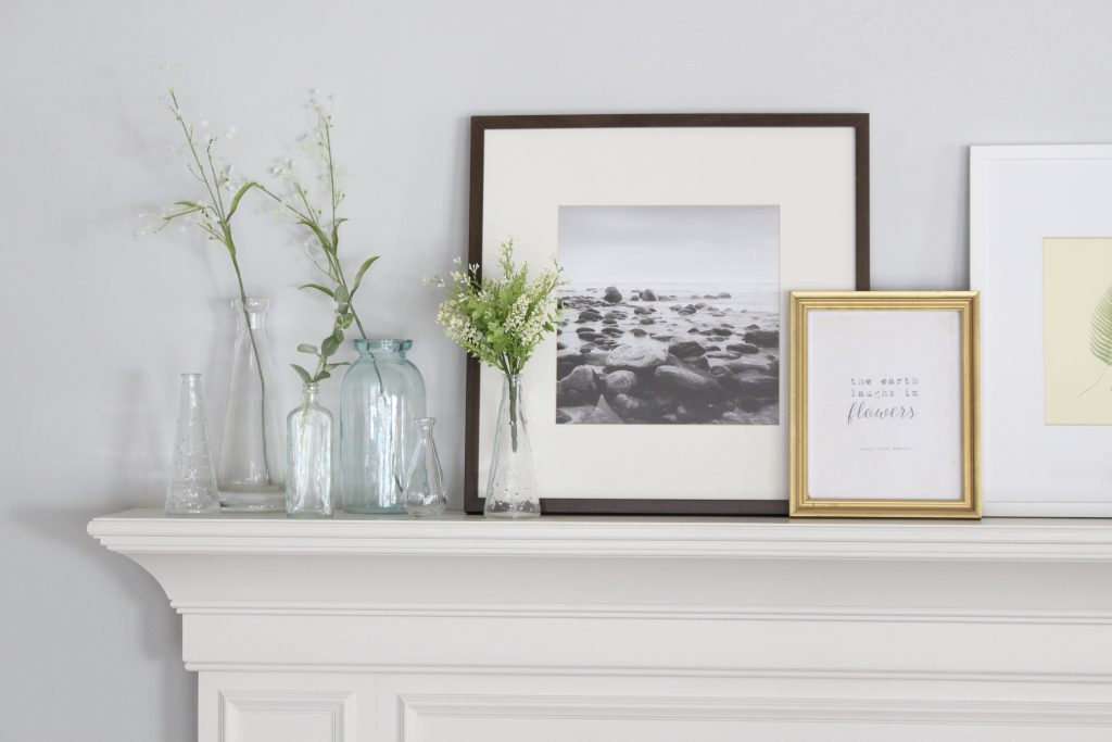 spring mantel decor- how to decorate your mantel for spring- mantles- mantel decorating- spring decor- fresh spring ideas- layered frames- wall decorating ideas- home design- diy- diy projects- seasonal mantel decor- craft ideas