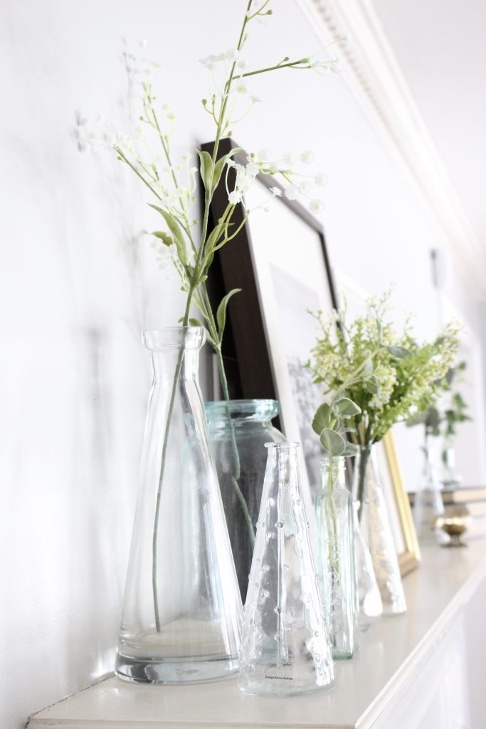 spring mantel decor- how to decorate your mantel for spring- mantles- mantel decorating- spring decor- fresh spring ideas- layered frames- wall decorating ideas- home design- diy- diy projects- seasonal mantel decor- clear vases