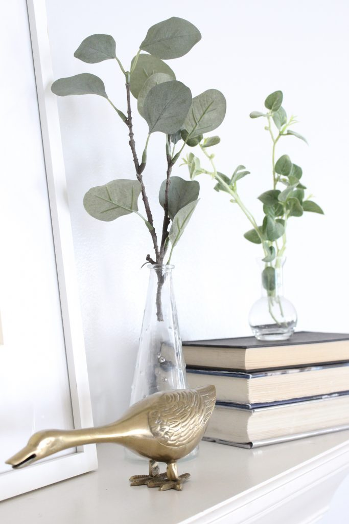 spring mantel decor- how to decorate your mantel for spring- mantles- mantel decorating- spring decor- fresh spring ideas- layered frames- wall decorating ideas- home design- diy- diy projects- seasonal mantel decor- simple spring decorating