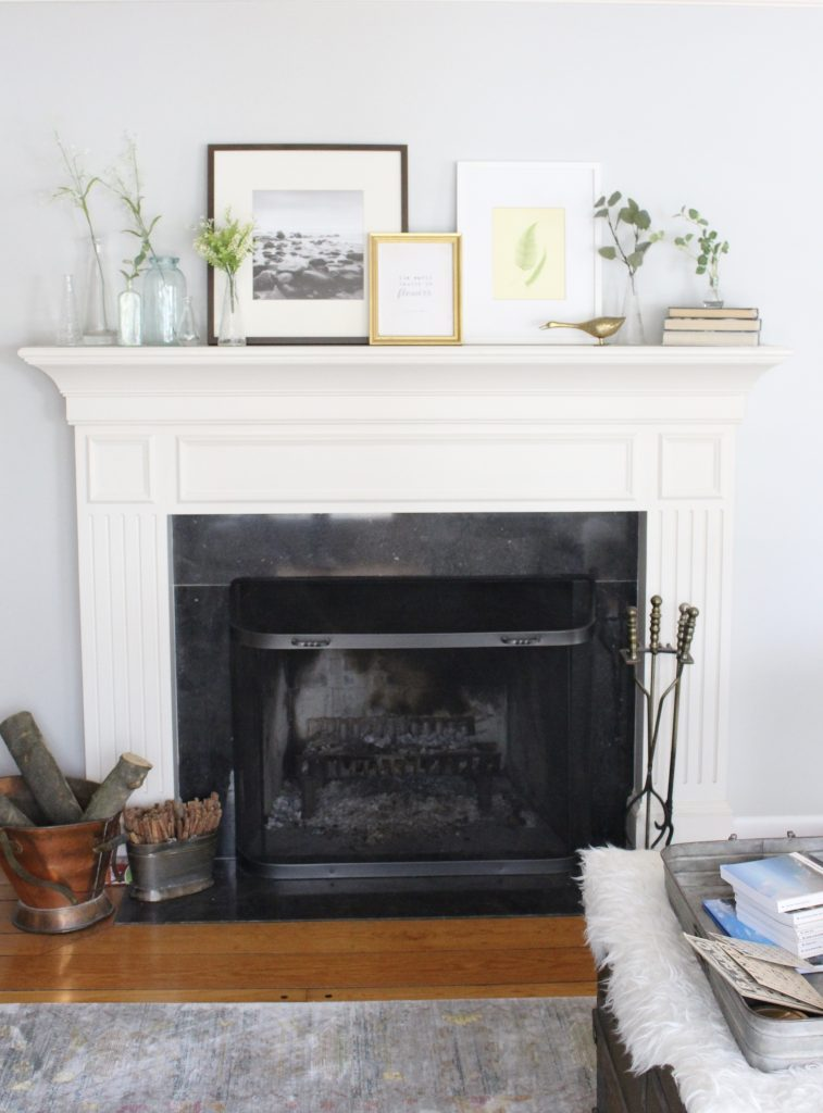 spring mantel decor- how to decorate your mantel for spring- mantles- mantel decorating- spring decor- fresh spring ideas- layered frames- wall decorating ideas- home design- diy- diy projects- seasonal mantel decor- fireplace mantel