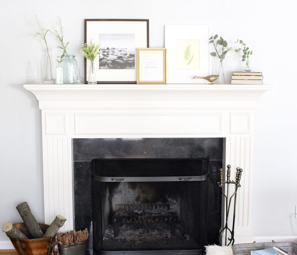 spring mantel decor- how to decorate your mantel for spring- mantles- mantel decorating- spring decor- fresh spring ideas- layered frames- wall decorating ideas- home design- diy- diy projects- seasonal mantel decor- fireplace