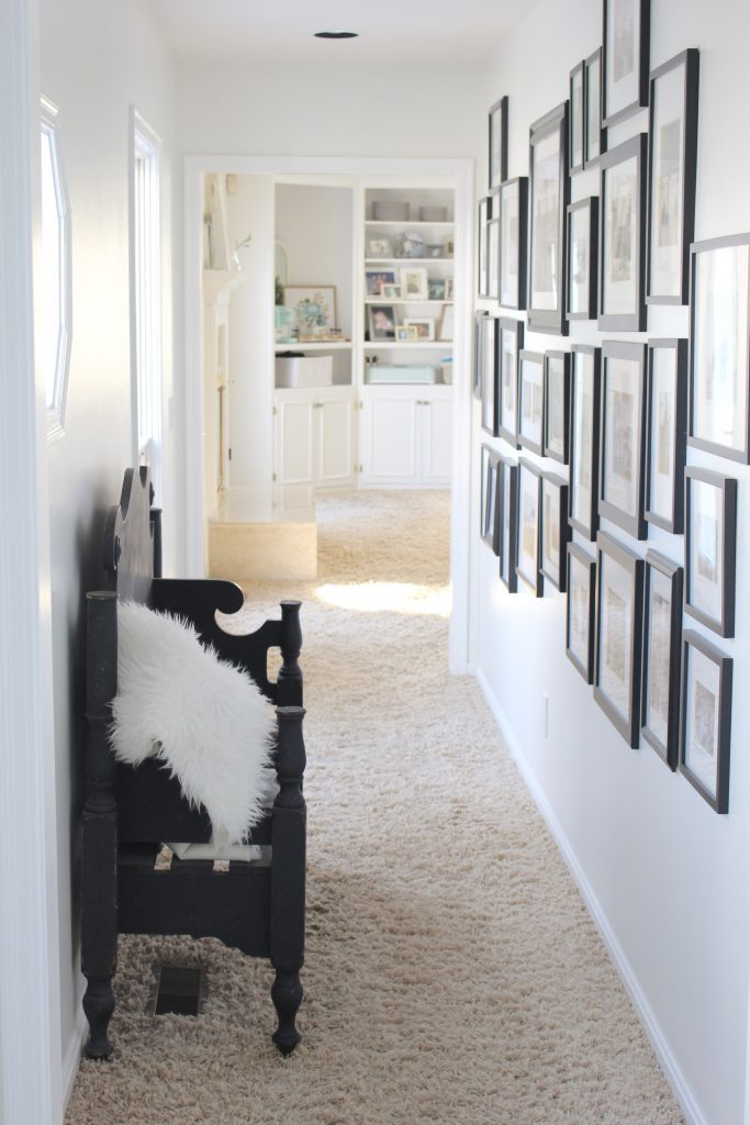 travel gallery- wall gallery- travel photos- how to display- hallway decorating- long hallway- decor- wall decor- black and white photographs- master suite- hallway decor- bedroom decor
