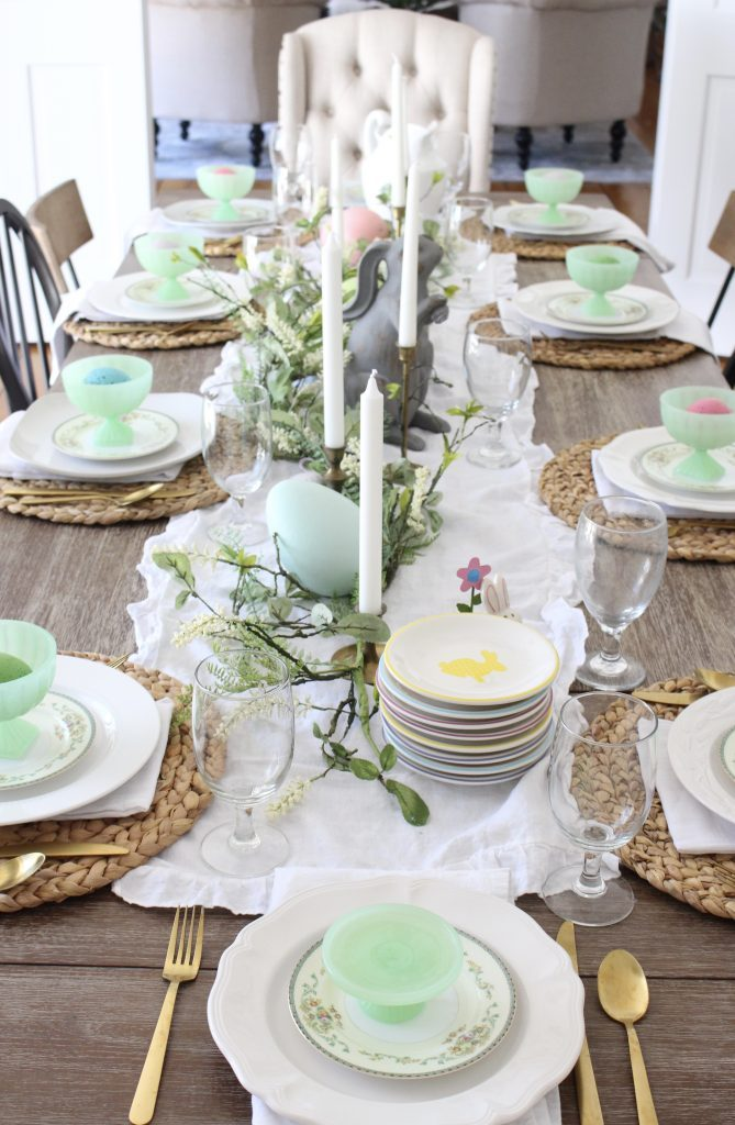 Tablescape- Easter- spring- decor- dining room- table setting- bunnies- oversized eggs- garland- home decor- table- farmhouse- vintage china- antique brass candlesticks