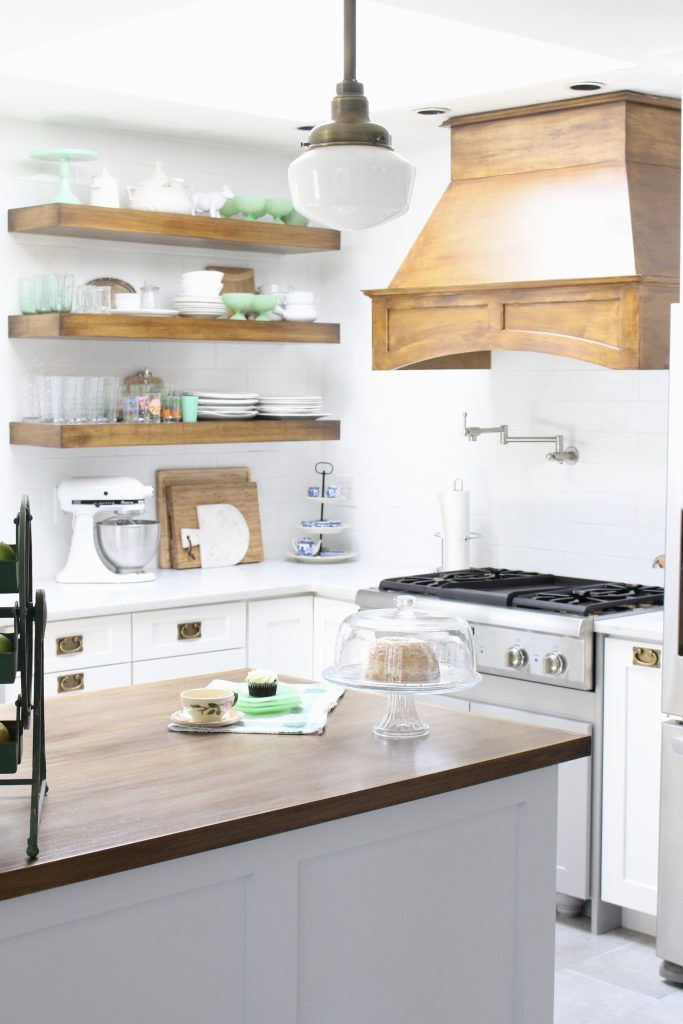 White- Cottage Kitchen- Renovation- Reveal- kitchen design- kitchen decorating ideas- kitchen decor ideas- room design- home decor- design- open shelving- custom island- white cabinets- professional appliances- DIY- Do it Yourself- wood range hood- cottage design- farmhouse kitchen- gray cabinets- island with open shelving- stained wood top