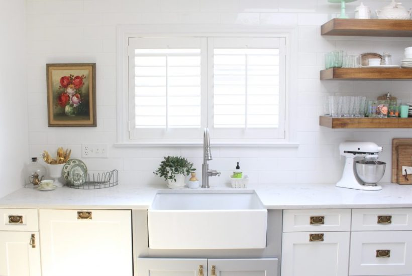 White- Cottage Kitchen- Renovation- Reveal- kitchen design- kitchen decorating ideas- kitchen decor ideas- room design- home decor- design- open shelving- custom island- white cabinets- professional appliances- DIY- Do it Yourself- wood range hood- cottage design- farmhouse kitchen- gray cabinets- Sunburst Shutters- Custom Shutters- Window Coverings