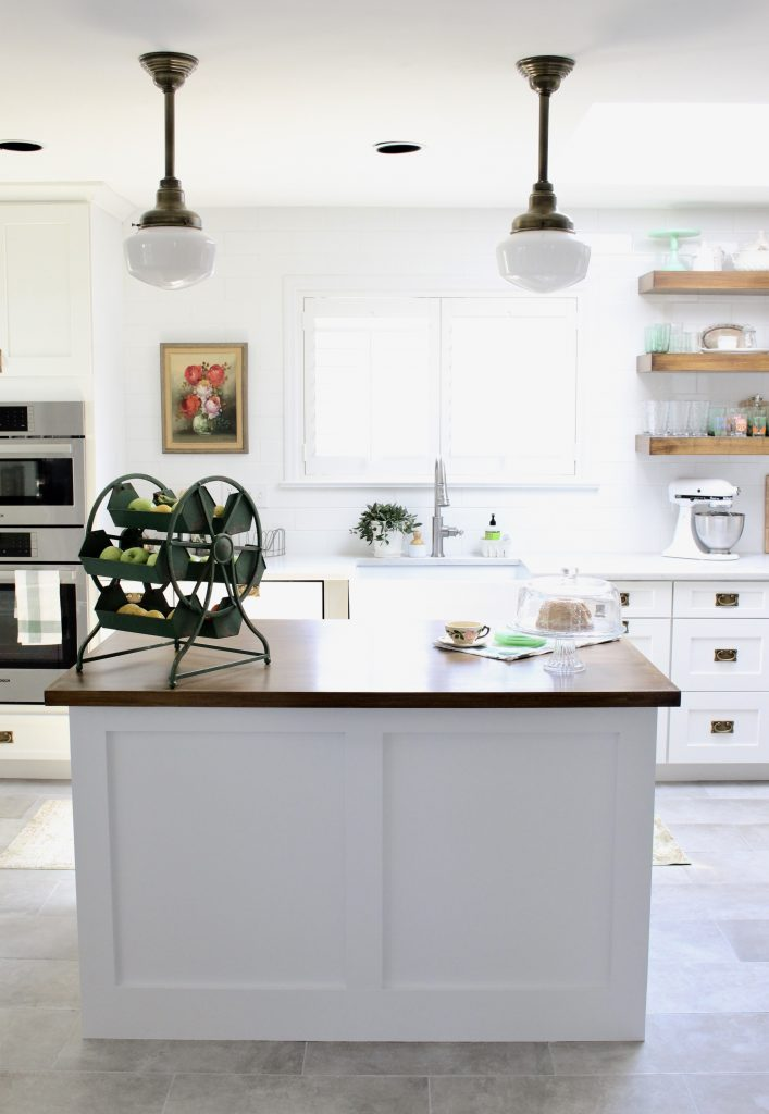 White- Cottage Kitchen- Renovation- Reveal- kitchen design- kitchen decorating ideas- kitchen decor ideas- room design- home decor- design- open shelving- custom island- white cabinets- professional appliances- DIY- Do it Yourself- wood range hood- cottage design- farmhouse kitchen- gray cabinets- Thermador professional range with griddle- peninsula with stools- wine and beverage bar- nook- double wall ovens