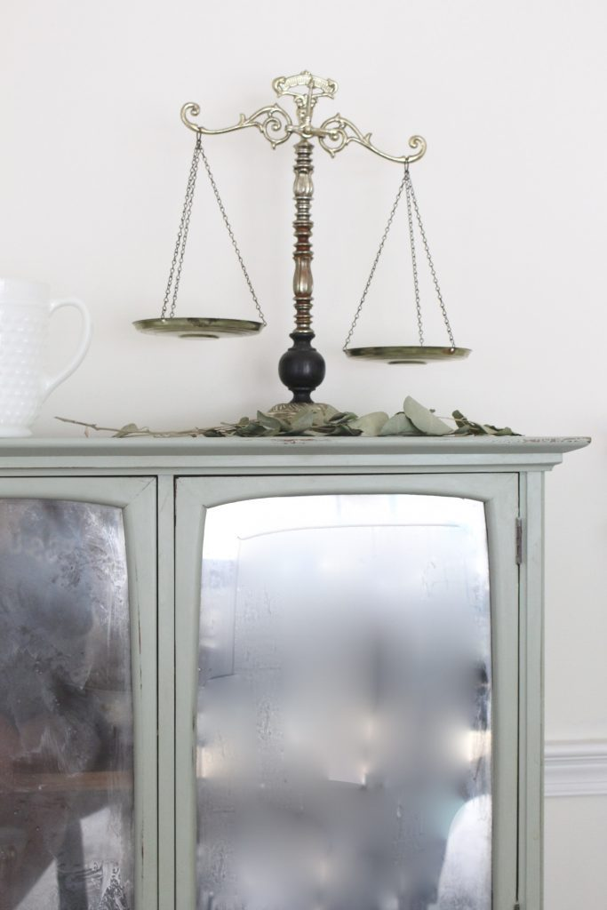 Hutch cabinet makeover- DIY- green- paint- cabinet- Do it Yourself projects- painted furniture- turning a hutch into a cabinet with legs- adding legs to furniture- dining room- furniture- storage piece- mirror spray paint- home decor- room design- thrift store makeover