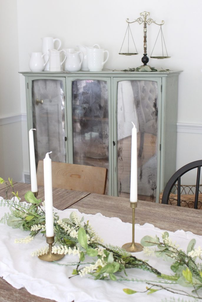 Hutch cabinet makeover- DIY- green- paint- cabinet- Do it Yourself projects- painted furniture- turning a hutch into a cabinet with legs- adding legs to furniture- dining room- furniture- storage piece- mirror spray paint- home decor- room design- dining room decor