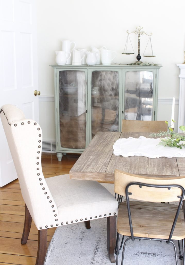 Hutch cabinet makeover- DIY- green- paint- cabinet- Do it Yourself projects- painted furniture- turning a hutch into a cabinet with legs- adding legs to furniture- dining room- furniture- storage piece- mirror spray paint- home decor- room design- farmhouse style