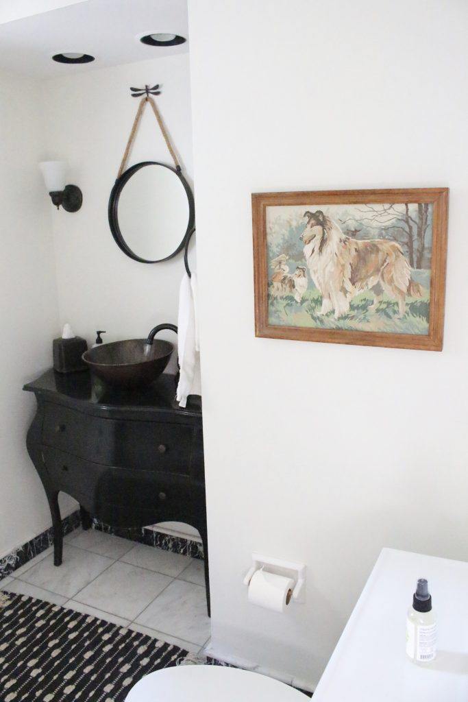 Vintage Paint By Number art pieces decorating a small bathroom space ...