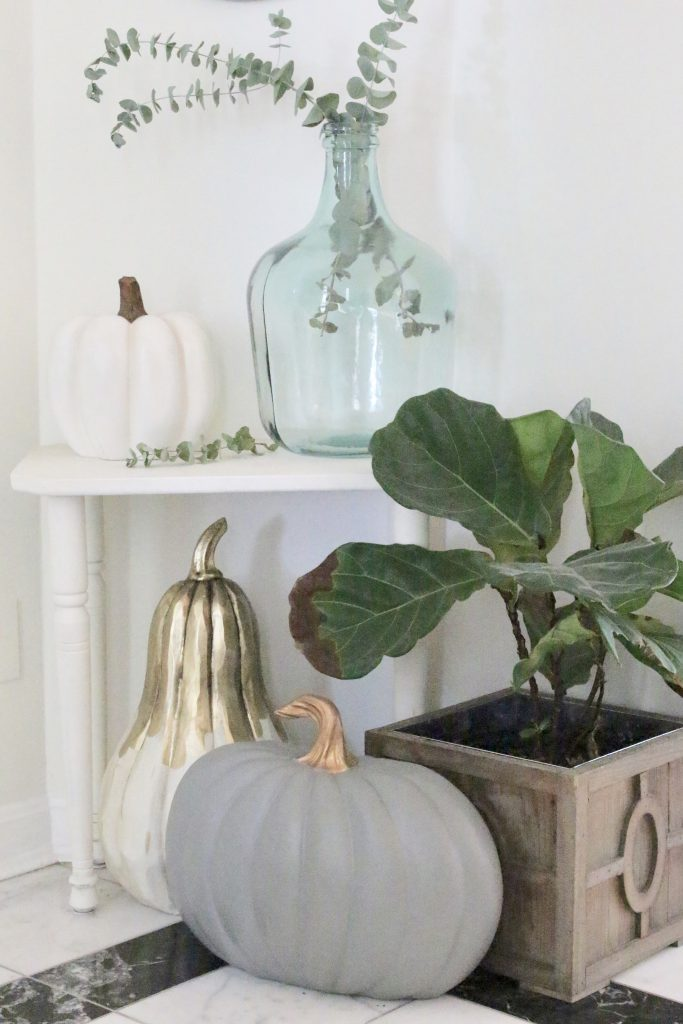 A fall vignette in the entryway- seasonal decor- fall decorating- wooden pumpkins- autumn decor- decorating an entry- home design- fiddle leaf fig- small corner decor- decorating small spaces