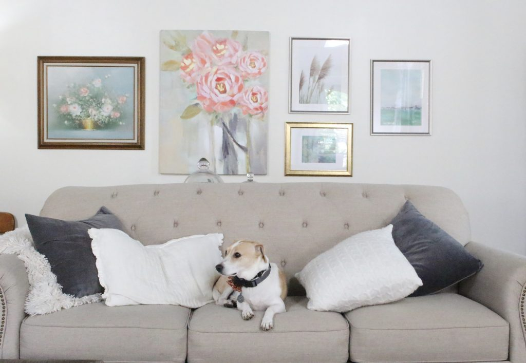 A new gallery wall in our family room- pastels- paintings- gallery wall- arrangement- wall decor- artwork- pale colors- neutrals- updated wall art
