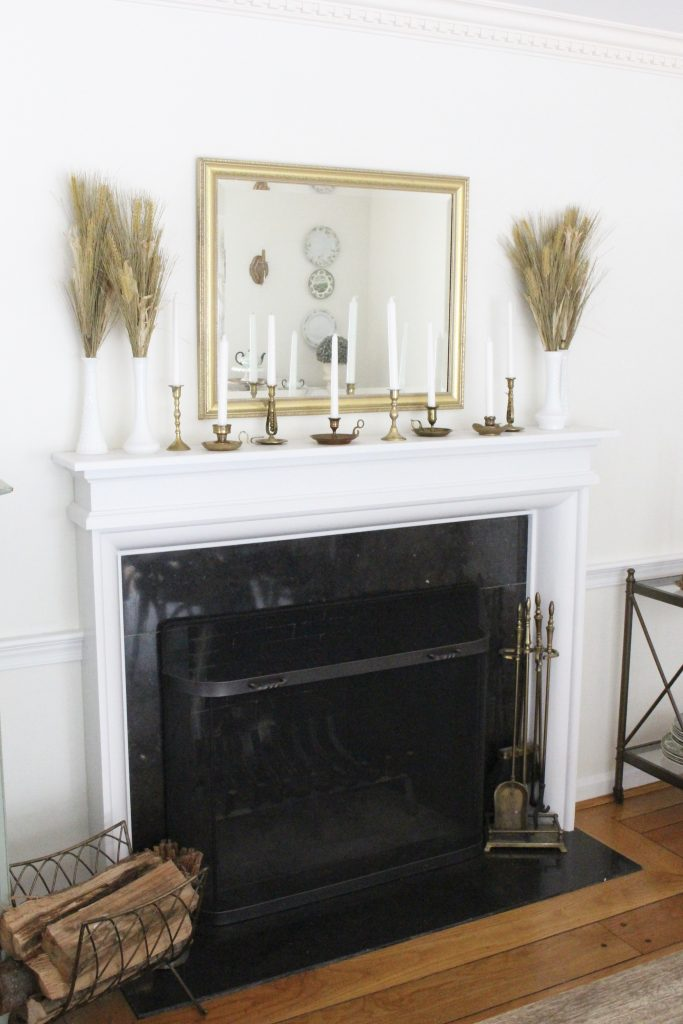 Simple neutral fall colors in our dining room- dining room- fall decor- neutral- living spaces- gold- brass- candlesticks-milk glass- fireplace decor mantel- decorating for fall- seasonal- fall mantel- tablescape