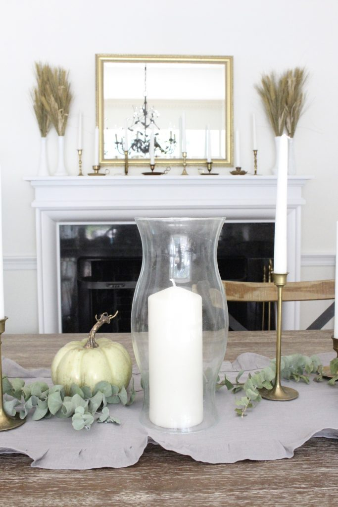 Simple neutral fall colors in our dining room- dining room- fall decor- neutral- living spaces- gold- brass- candlesticks-milk glass- fireplace decor mantel- decorating for fall- seasonal- glass sconces- dining room tablescape