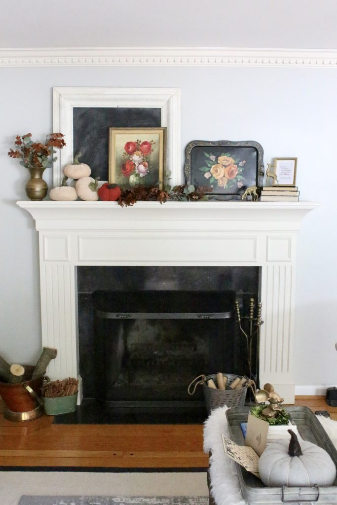 A vintage fall mantel- vintage- fall- classic- mantel- brass- fall decor- fall decorating- mantle- brass animals- velvet pumpkins- room design- mantel decor- decorating your mantel for fall- classic autumn decor- oil paintings- black tray- fireplace decor- seasonal- library- office