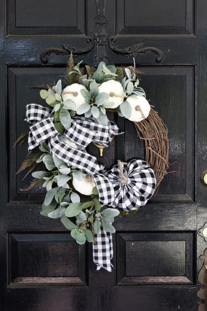 White brick ranch home- DIY wreath- fall decor- decorating a small porch for fall- cottage home- outdoor decorating- home design- autumn decor- pumpkins- mums- front porch- handmade wreath- decorating with black and white- gingham
