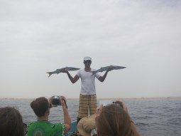 Our guide Rashid holding up the catch of the day - two barracudas aka our lunch.