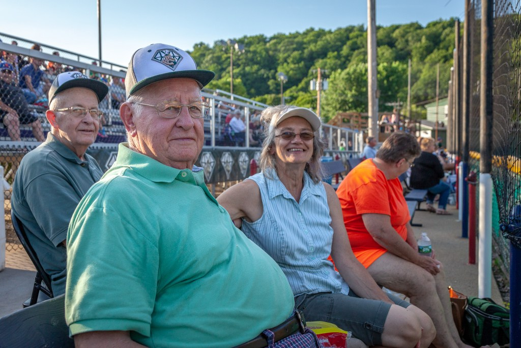 Maynard Blask, Carol McMahon, Susan Mettot, and Charlie Fitzgerald take in the DiamondDawgs game at Veteran's Memorial Park.