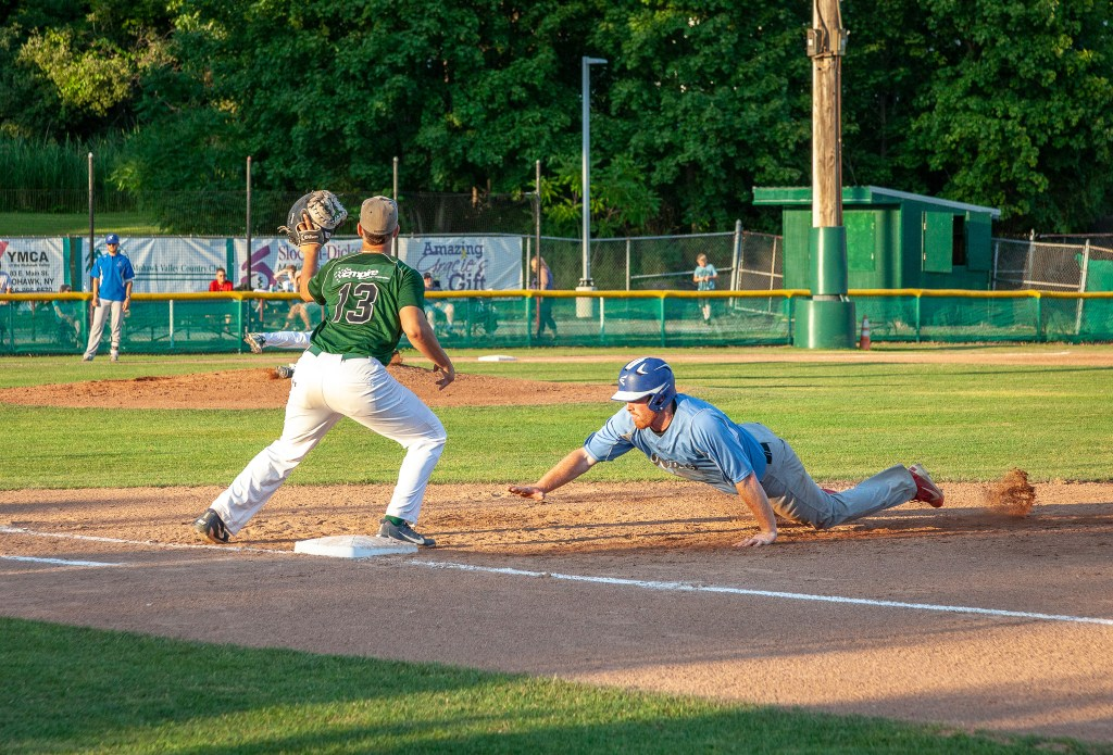 Photo by Dave Warner - Ryan Toohers, first baseman from Villanova University, prepares to put the tag on a player getting back to first. Toohers broke the Perfect Game Collegiate Baseball League record for runs batted in and tied the record for home runs this summer while playing for the DiamondDawgs.