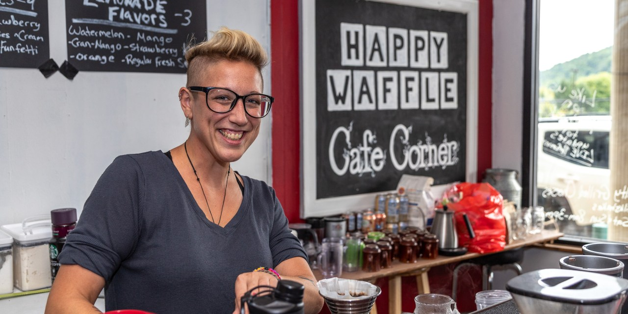 Photo by Dave Warner - Maria Salamone, owner of the Happy Waffle on Main St, makes a cup of coffee.