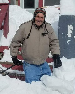 Photo submitted by Haze Grafix- Kenny Gee with a smile, a shovel, and a ton of snow during his favorite time of the year.