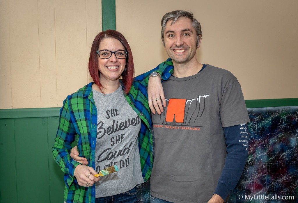Photo by Dave Warner - Laura and Matt Powers getting ready to work on painting the walls at their new business on Main Street - Meeples Mug House.