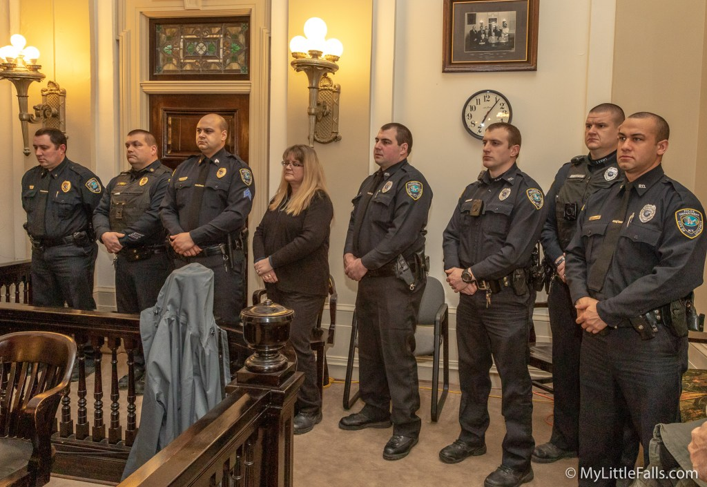 Photo by Dave Warner - Members of the Little Falls Police Department attended the Common Council meeting to show their support for Chief Masi during the reading of his Proclamation.