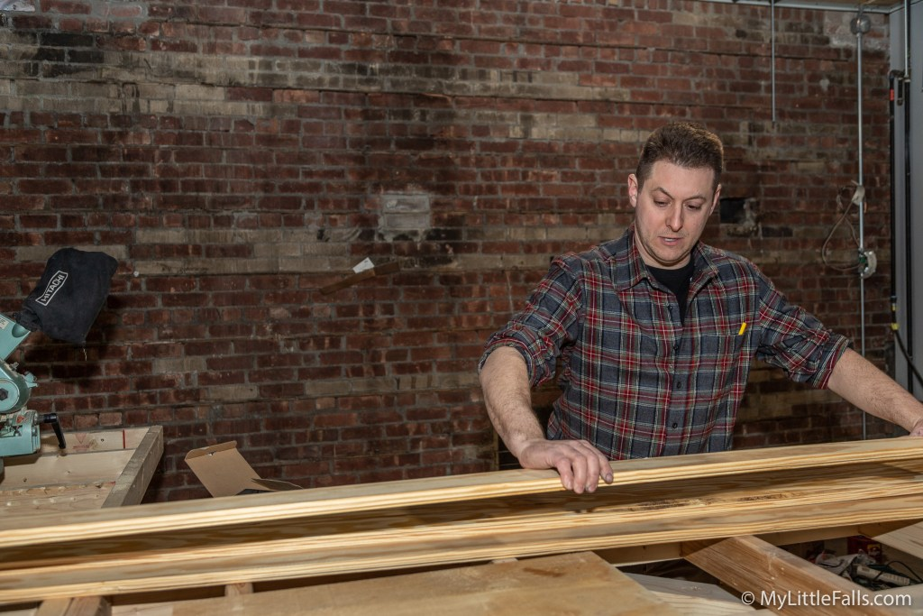 Photo by Dave Warner - Mike George works on the bar in the all season portion of the Ironrock Brewing location.