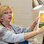 Canastar holds painting class at Holy Family Parish