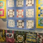 Ilion Piecemakers Quilt Guild hangs show at the Library