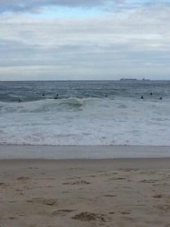 attractingmany surfers to Copacabana Beach.