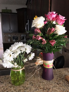 White daisies from Drew a week before. Purple vase of flowers from my best friend for today.