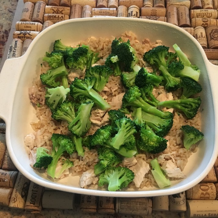Spray the bottom of a casserole dish with cooking spray.  Spread cooked rice into bottom of dish and place chicken over top of rice then broccoli on top of chicken.