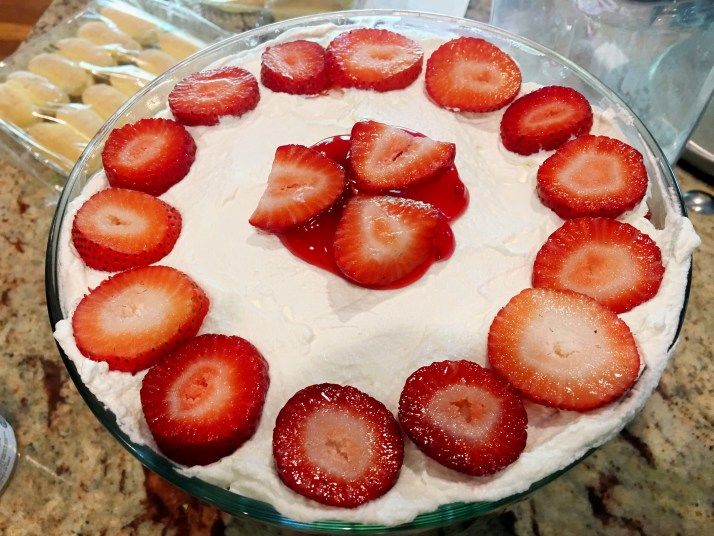 Top off with whipped cream and fresh sliced berries. Refrigerate for 1 hour and serve.