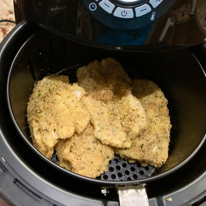 place breaded fish into the airfryer basket and close turn on airfryer and press the fish option button temperature should be set at 350℉ cook for 10 minutes ( this airfryer has the time preset)