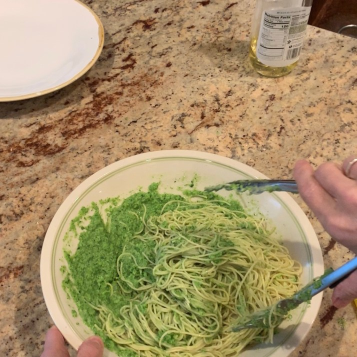add broccoli, garlic, and oil into a food processor and pulse 3 or 4 times only after draining the angel hair pasta, put into a large serving dish and toss in the broccoli pesto  add the reserved pasta water and toss it all together