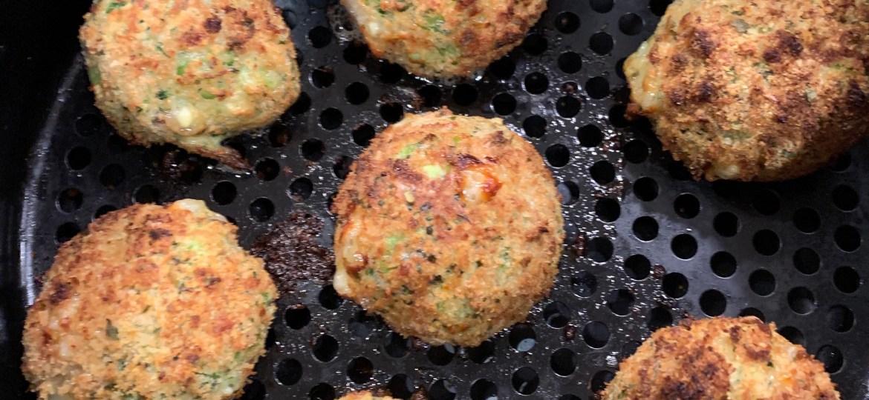 Cheesy Broccoli Air Fryer Croquettes in an air fryer basket