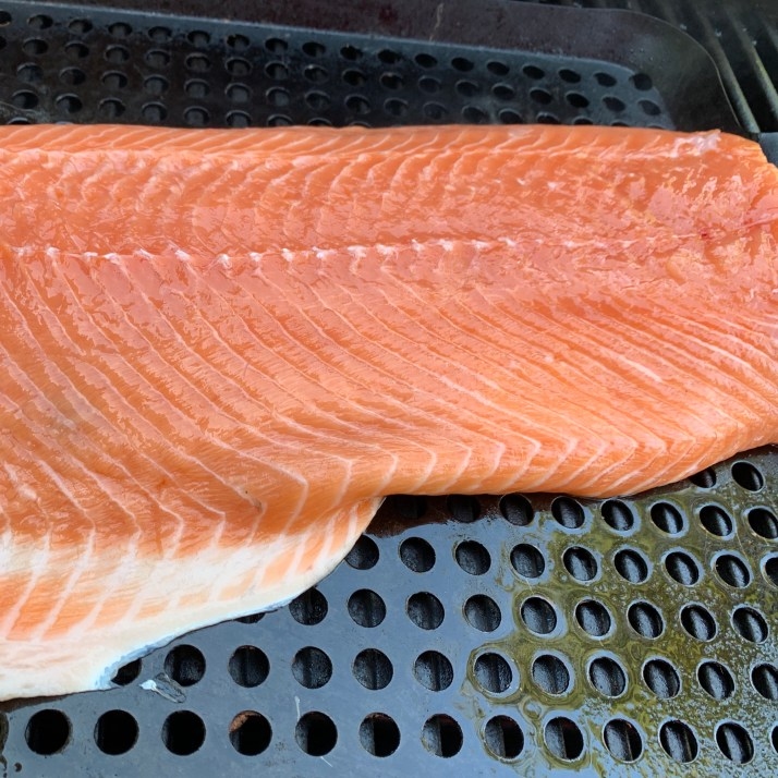 preheat grill on medium high heat  spray your grill pan with cooking oil, place the salmon on top