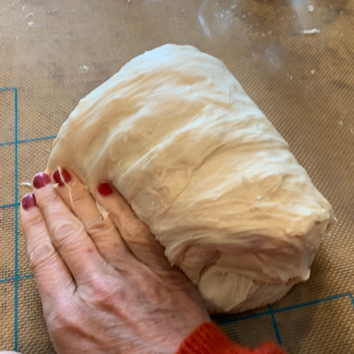 after resting period, scrape dough onto a clean surface.  Using wet fingers, fold the dough over itself and give the dough a quarter turn and continue this process for 6 times.  Tip: avoid adding more flour even if the dough is sticky, as you want to keep the higher water/flour ratio.