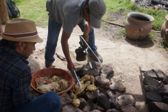 Placing the ingredients on the hot stones