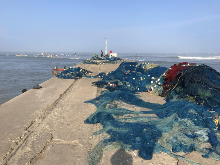 Fishing nets on the pier at Jamestown Accra. Fishing boats are in the background