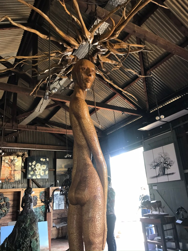 The Platform Gallery Lions River Howick - A sculpture of a man with sun rays on his head stands at the centre