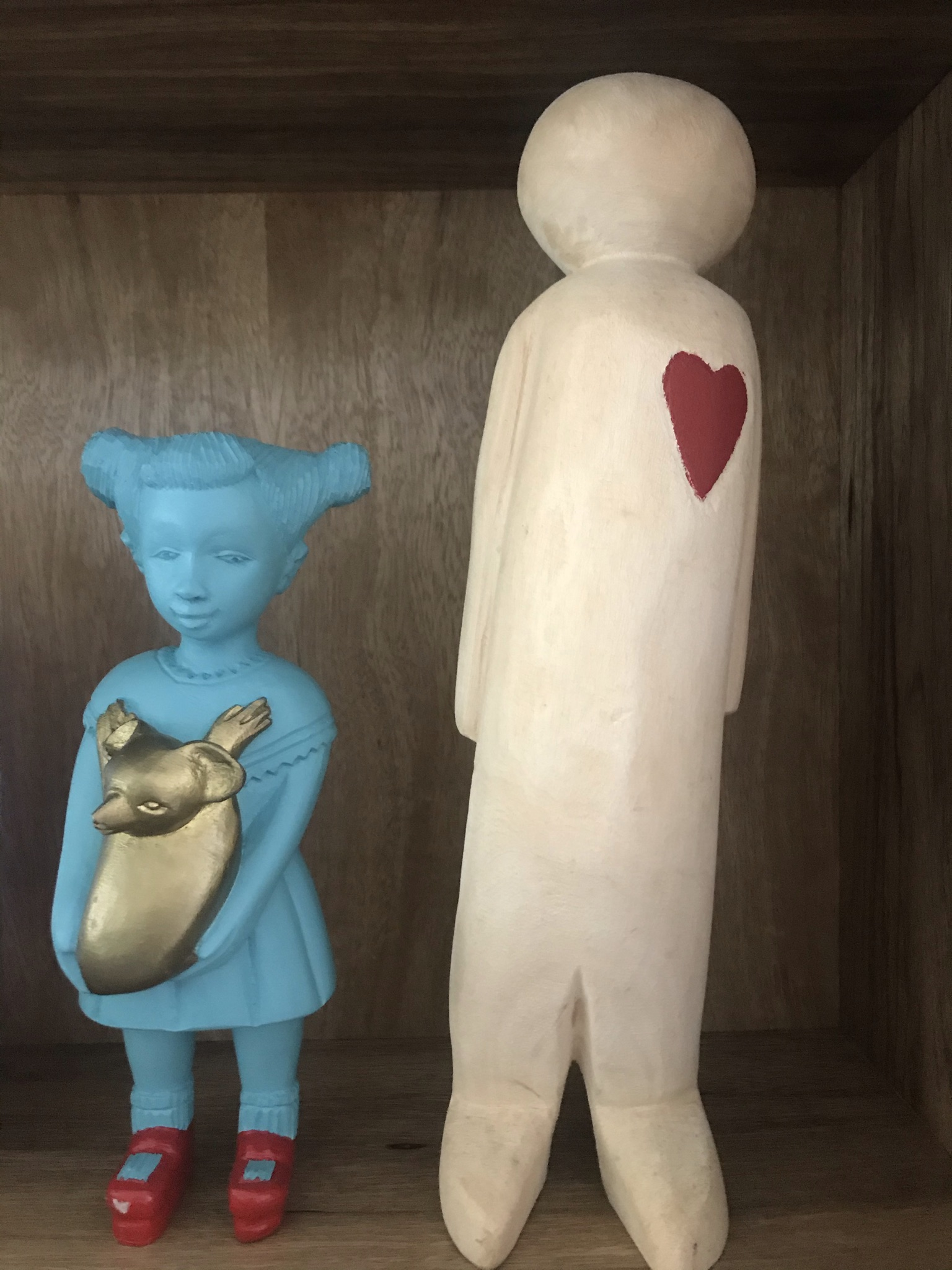 Koala Kate Doll made by Manoushka Kraal stands next to a large wooden figure of a man