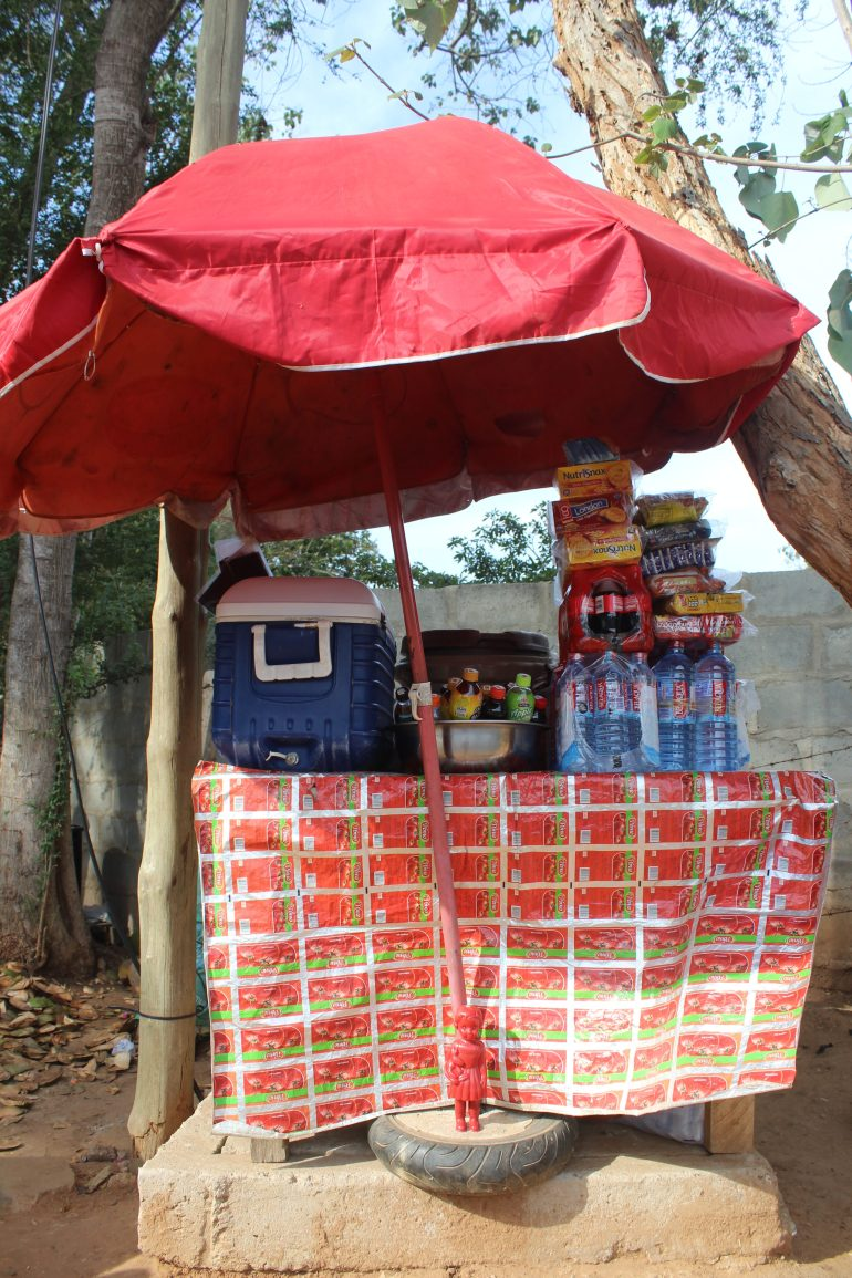 Red Clonette doll in Accra Ghana at a kiosk selling cooldrinks