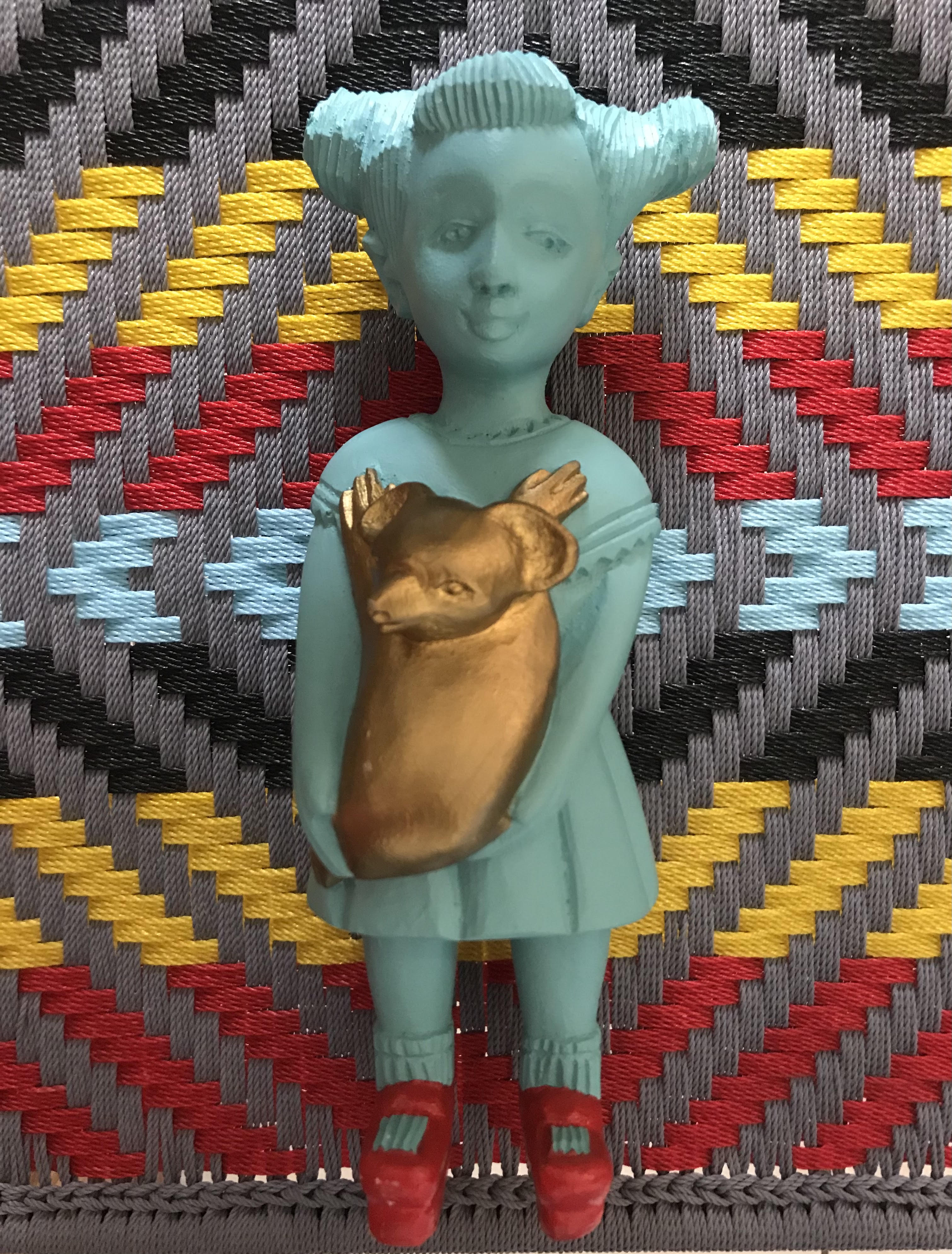 Koala Kate by Noush Projects Manoushka Kraal lies on top of a chair made by Ghanaian Joel of Calao Creations