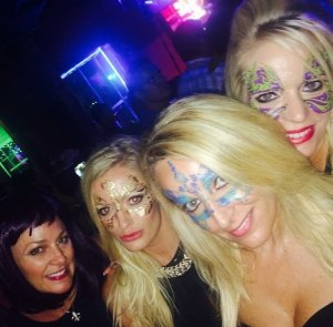 girls at masquerade party with temporary tattoo masks