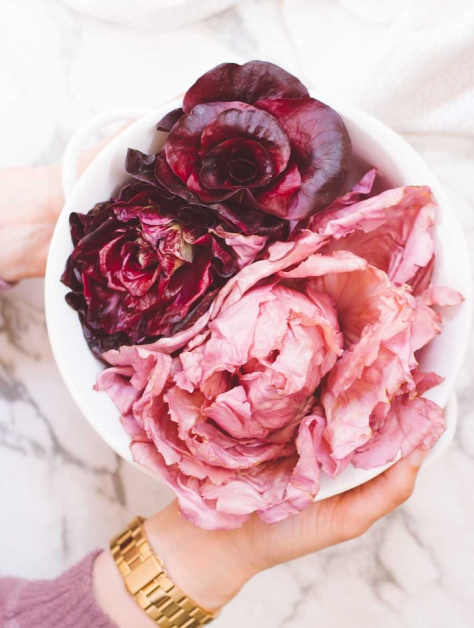 Pink Radicchio in a white bowl with hands
