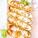 zucchini pizza boats on a white plate