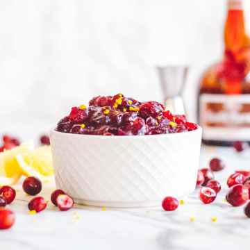 White cup full of cranberry sauce with grand marnier