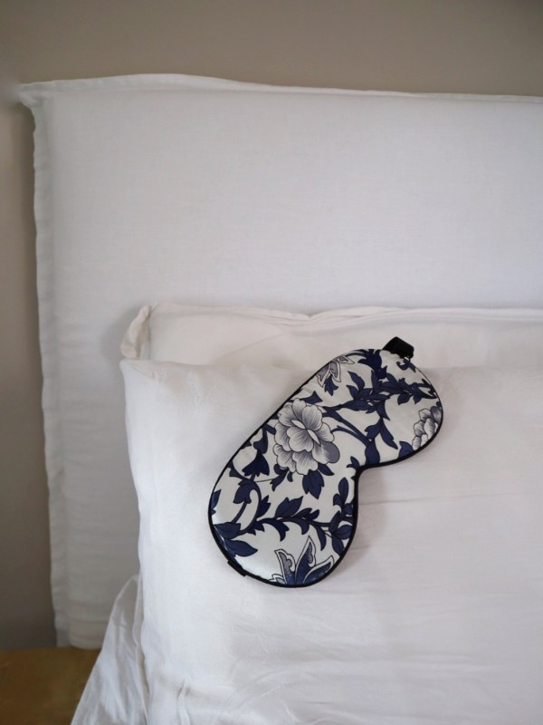 silk mask on corner of a white pillow